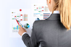 Young businesswoman showing graphs by pen Stock Photography