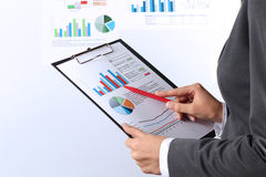 Young businesswoman showing graphs by pen Royalty Free Stock Photos