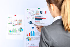 Young businesswoman showing graphs by pen. Presentatoin stock images