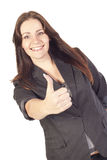 Young businesswoman showing hand ok sign Stock Photo