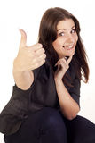 Young businesswoman showing hand ok sign Stock Images