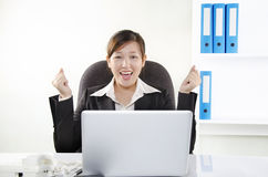 Young businesswoman showing her excitement Stock Images