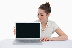 Young businesswoman showing a laptop Royalty Free Stock Photos