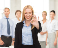 Young businesswoman showing ok sign Stock Photography