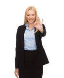 Young businesswoman showing ok sign Royalty Free Stock Images