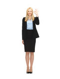 Young businesswoman showing ok sign Royalty Free Stock Photos