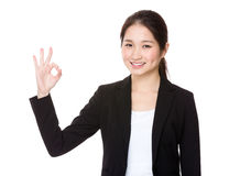 Young Businesswoman showing ok sign gesture Stock Photo