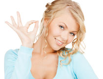 Young businesswoman showing ok sign Royalty Free Stock Photo