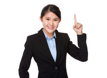Young businesswoman showing pointer up Stock Photos