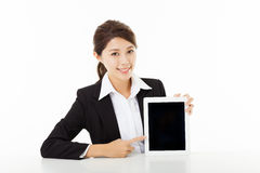 Young businesswoman  showing and pointing to the tablet Royalty Free Stock Photo