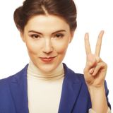 Young businesswoman showing a victory sign i Stock Photography