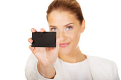 Young businesswoman shows business card Royalty Free Stock Images