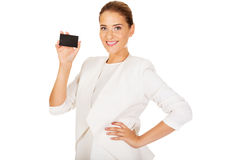 Young businesswoman shows business card Stock Images