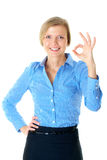 Young businesswoman shows OK gesture, isolated Royalty Free Stock Photography