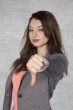 Young businesswoman shows thumb down Royalty Free Stock Image