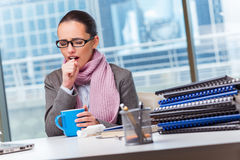 The young businesswoman sick in the office Royalty Free Stock Photography