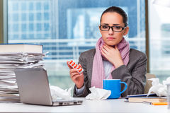 The young businesswoman sick in the office Royalty Free Stock Image