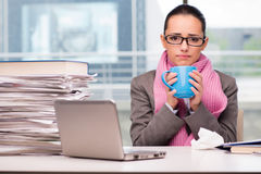 The young businesswoman sick in the office Royalty Free Stock Photos