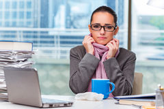 The young businesswoman sick in the office Royalty Free Stock Images