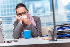 The young businesswoman sick in the office. Young businesswoman sick in the office Royalty Free Stock Photography