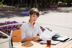 Business woman at a sidewalk cafe Stock Image
