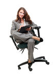 Young businesswoman siiting on office chair Royalty Free Stock Images