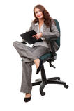 Young businesswoman siiting on office chair Stock Image