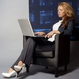 Young businesswoman sitting Stock Photo