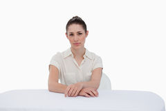 Young businesswoman sitting Stock Images