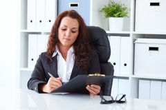 Young businesswoman sitting behind the desk Stock Image