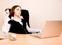 Young businesswoman sitting in the chair Royalty Free Stock Image