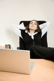 Young businesswoman sitting in the chair. And dreaming royalty free stock photos