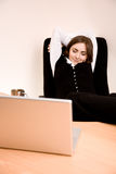 Young businesswoman sitting in the chair Stock Photos