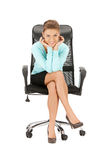 Young businesswoman sitting in chair Royalty Free Stock Image
