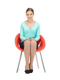 Young businesswoman sitting in chair Royalty Free Stock Images