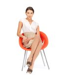 Young businesswoman sitting in chair Stock Photo