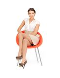 Young businesswoman sitting in chair Royalty Free Stock Photos