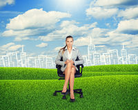 Young Businesswoman Sitting on Chair at Grassland Royalty Free Stock Image