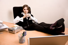 Young businesswoman  sitting in chair and holding a cup of tea Stock Photography