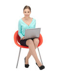 Young businesswoman sitting in chair with laptop Royalty Free Stock Photo