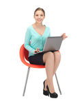 Young businesswoman sitting in chair with laptop Stock Photos
