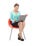 Young businesswoman sitting in chair with laptop Stock Photography