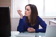 Businesswoman Looking At Her Fingernail stock photos