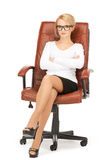 Young businesswoman sitting in chair Stock Images