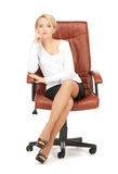 Young businesswoman sitting in chair Stock Image