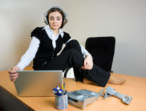 Young businesswoman sitting on the desk Royalty Free Stock Photo