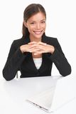Young businesswoman sitting at desk Stock Photos
