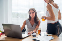 Young businesswoman sitting at desk front laptop Royalty Free Stock Photo
