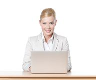 Young businesswoman sitting at a desk with laptop Stock Photos