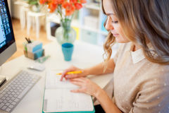 Young businesswoman sitting at desk and working. Beautiful woman and her workplace Stock Photos